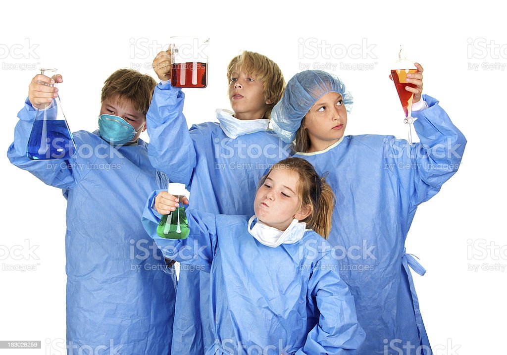 Curious Young Scientists with Beakers Wearing Scrubs royalty-free stock photo