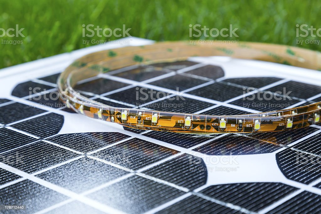 curled LED strip on photovoltaic solar panel royalty-free stock photo