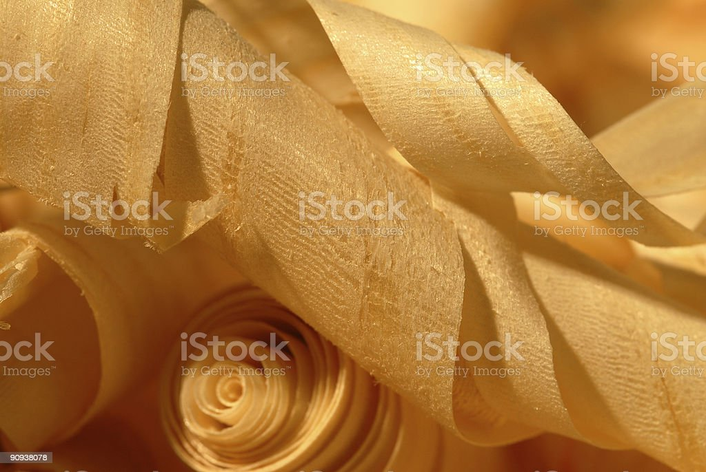 Curled light brown wooden shavings royalty-free stock photo