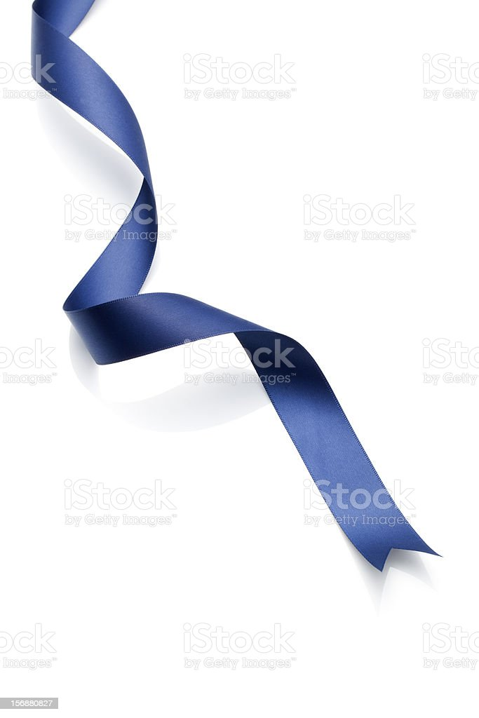 Curled navy blue ribbon isolated on white stock photo