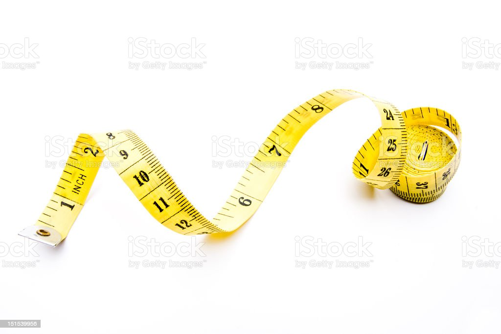 A curled up yellow measuring tape stock photo