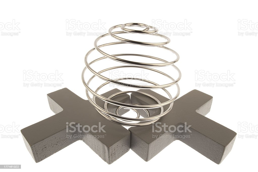 Curled wire globe on two crosses royalty-free stock photo