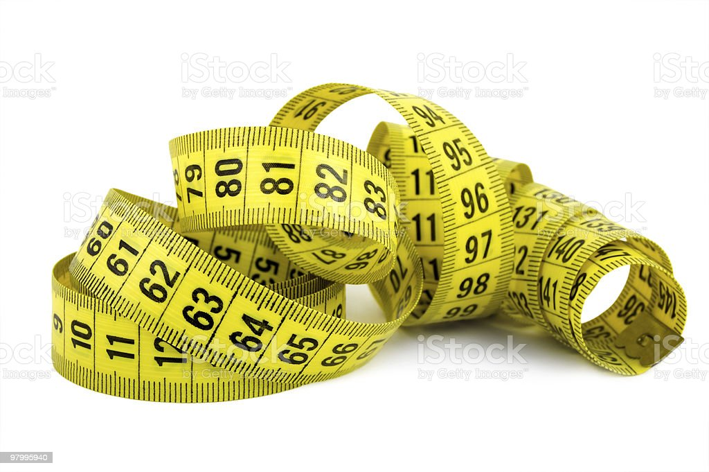 Curled yellow measuring tape on white background stock photo