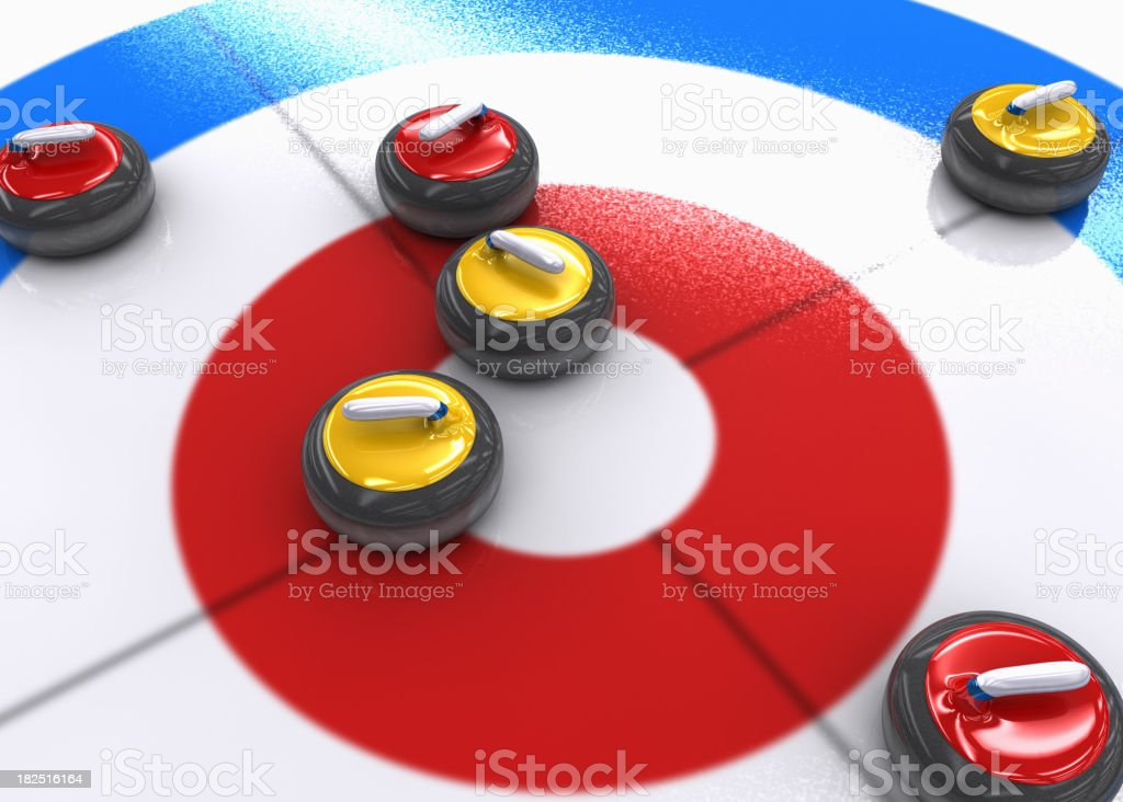 Curling rocks on ice stock photo
