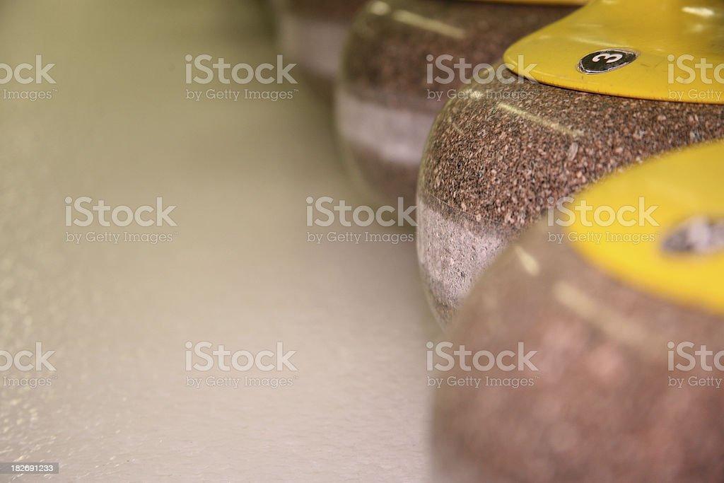 curling rocks stock photo
