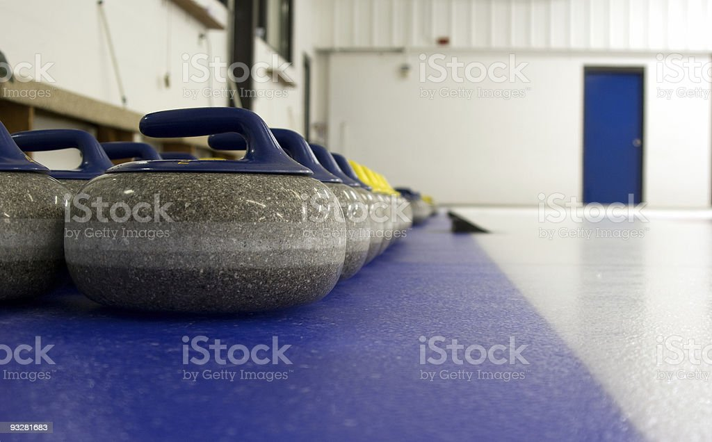Curling Rocks stock photo