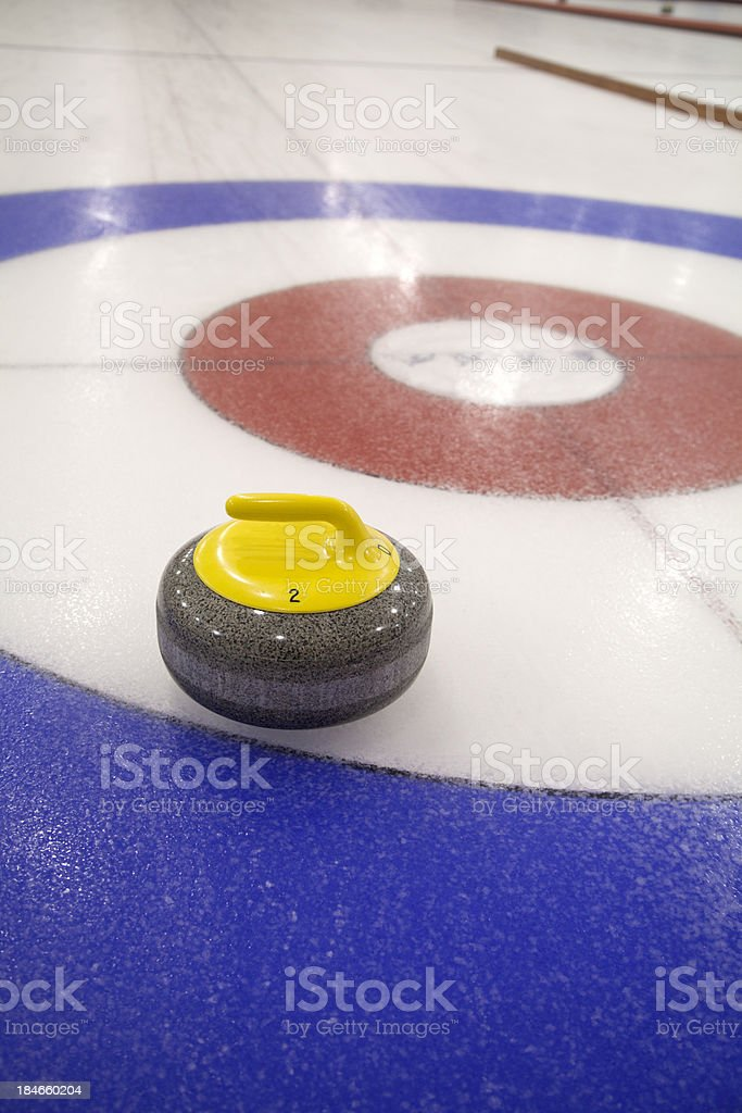 Curling Stone in the Target House on Ice stock photo