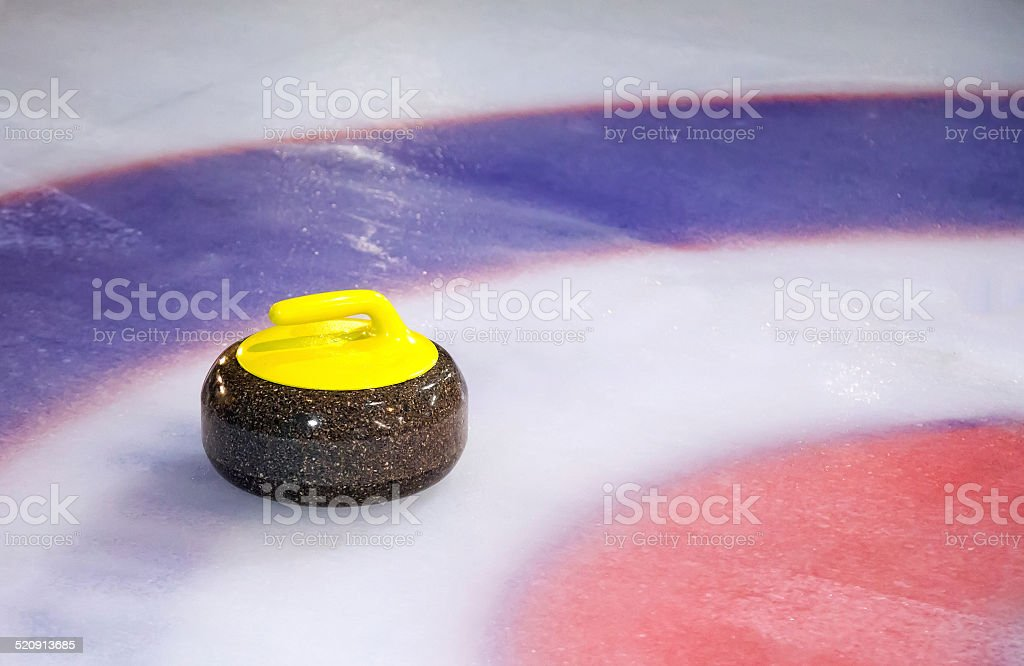 Curling Stone on Ice stock photo
