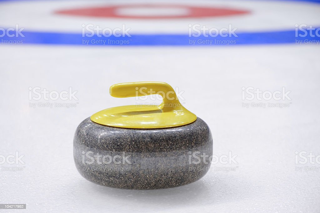 Curling stone stock photo