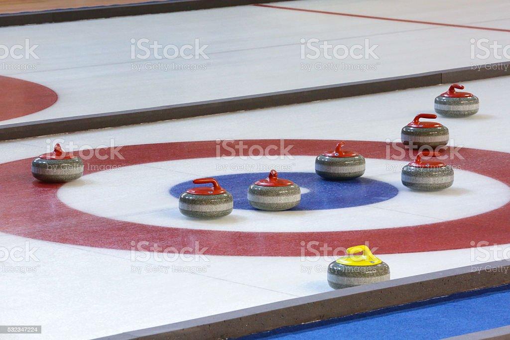 Curling stones stock photo