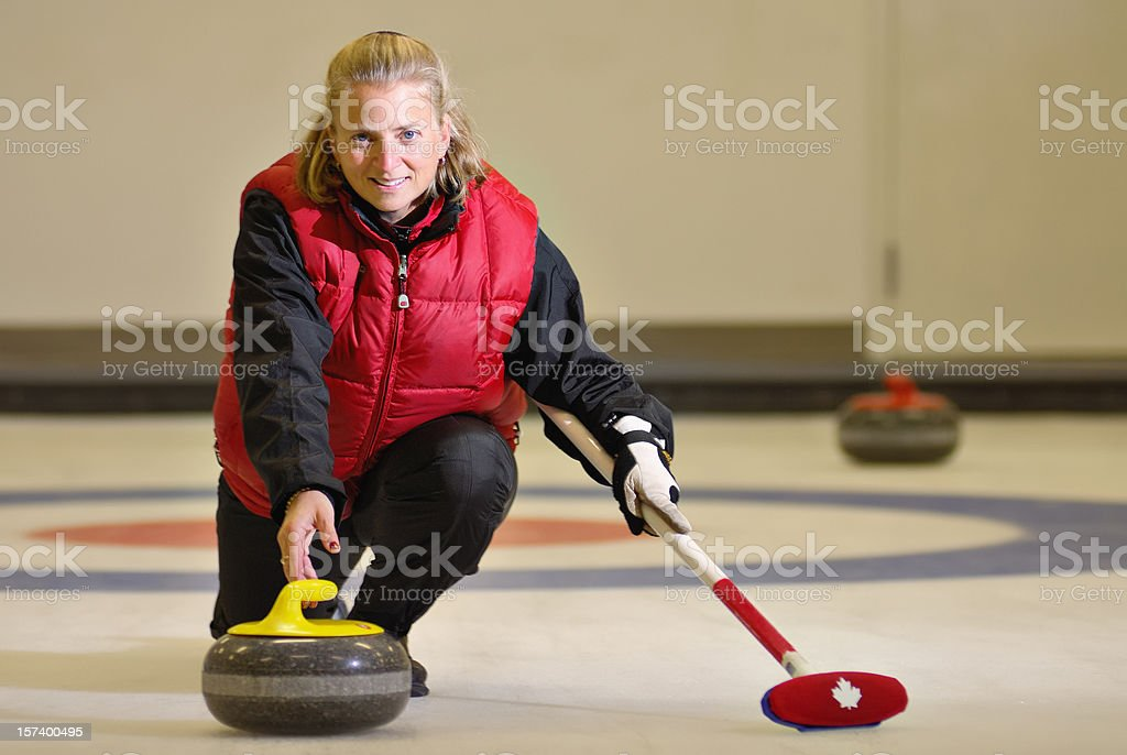 Curling Woman stock photo