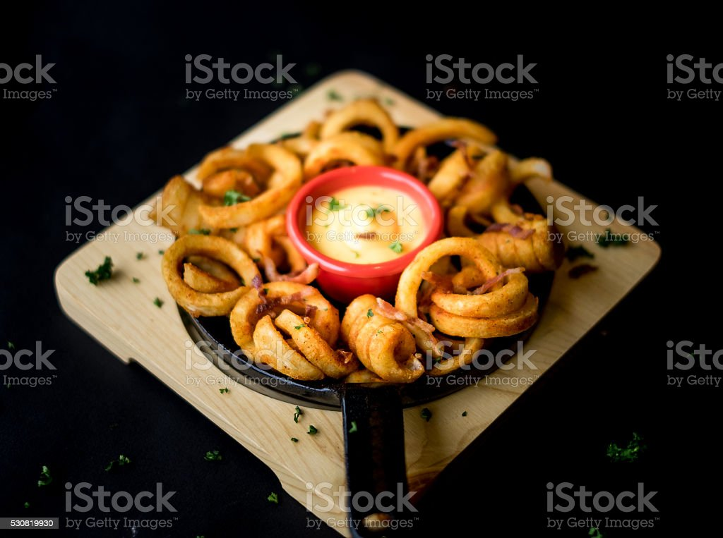 Curly Fries - black background stock photo
