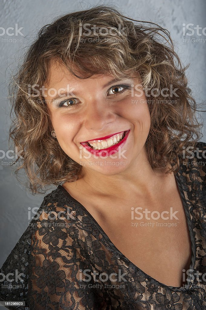 Curly girl in black dress royalty-free stock photo