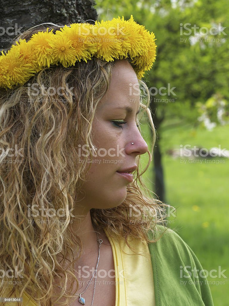 Curly girl with dandelion chain stock photo