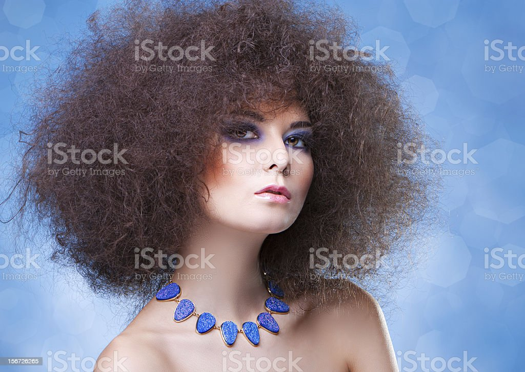 curly hair and blue make-up royalty-free stock photo