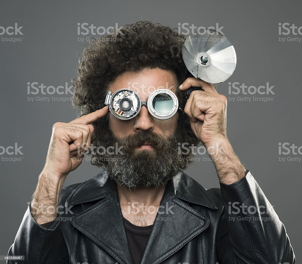 Curly haired inventor wearing glasses invention stock photo