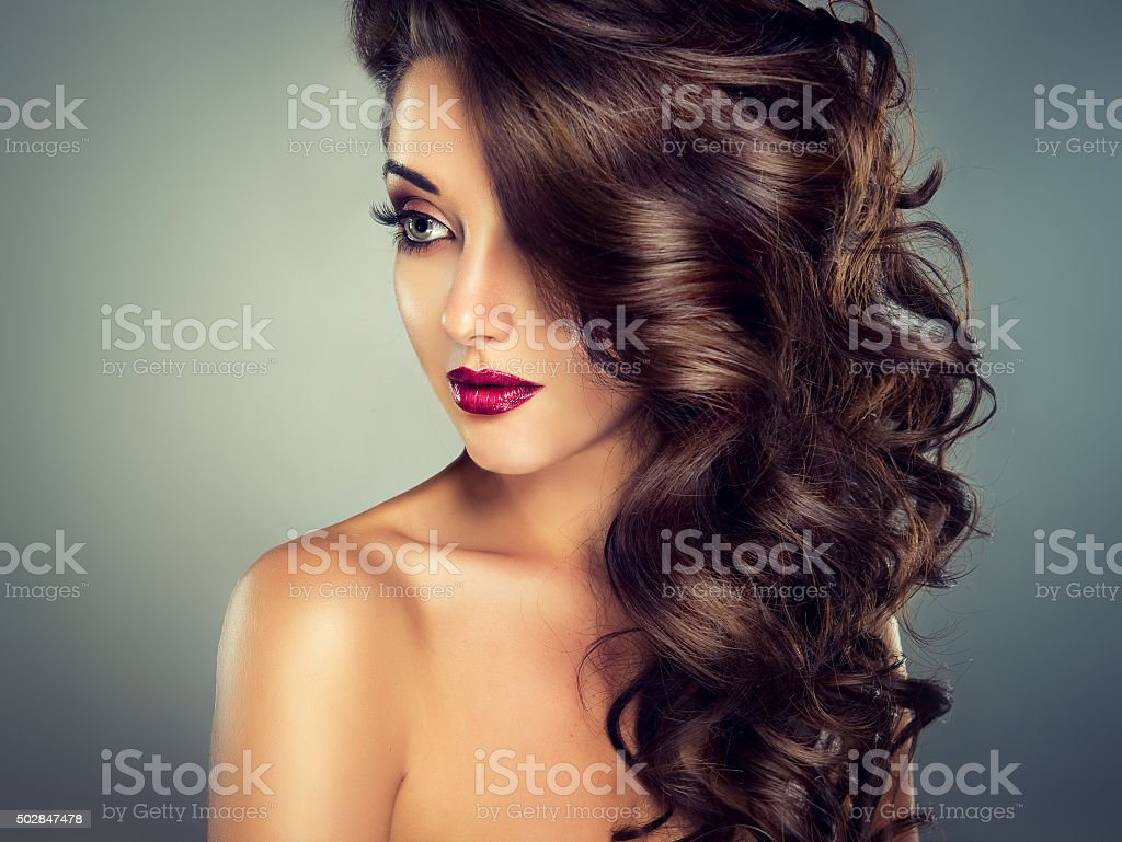 Curly hair.Sensual look. stock photo