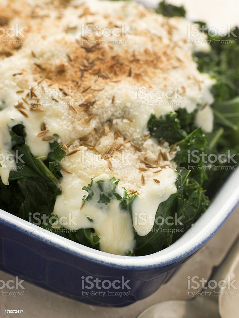 Curly Kale with Cheese Sauce Caraway Seeds and Breadcrumbs stock photo