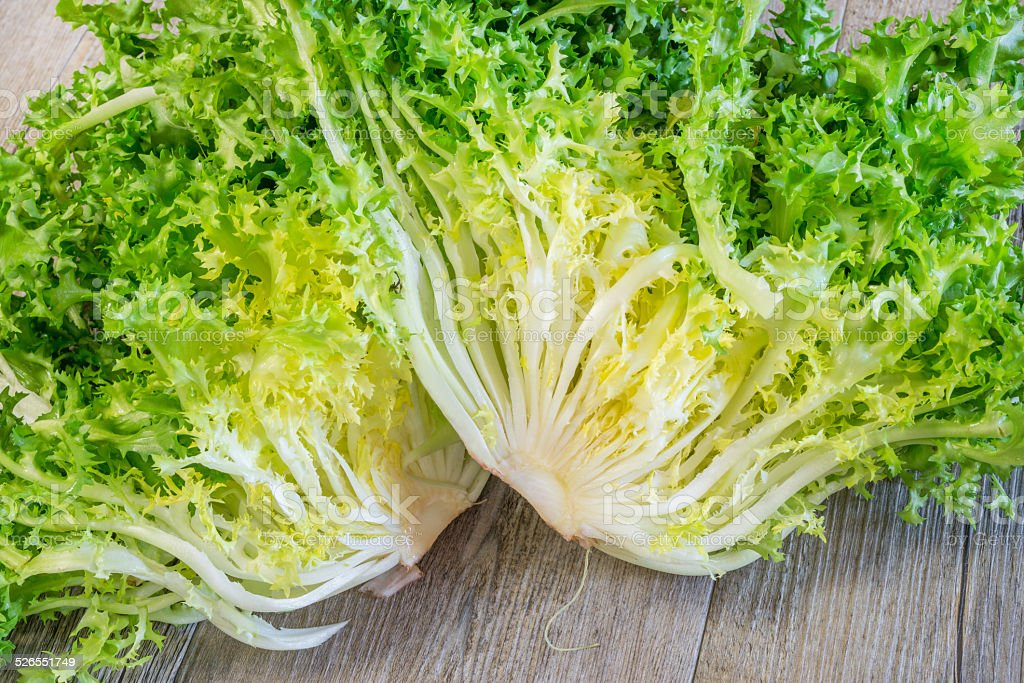 curly salad rotating on white background stock photo