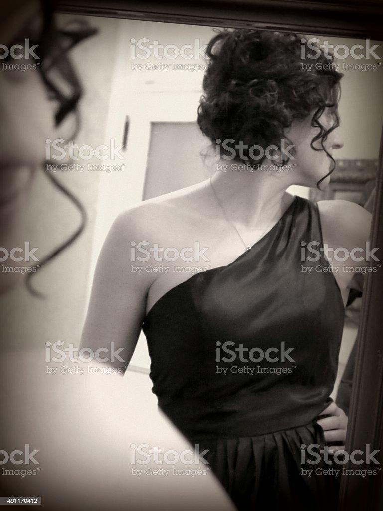 Curly Tendrils Hair Updo, Black Formal Shoulder Dress, Mirror Reflection stock photo