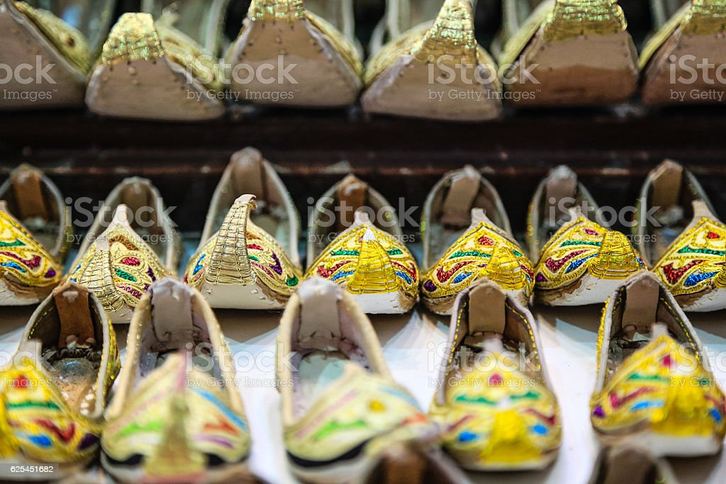 Curly toed slippers in Deira Souk, Dubai, United Arab E stock photo