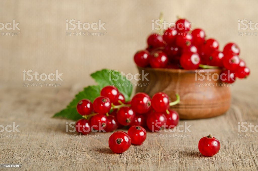 currant berries on wooden background stock photo