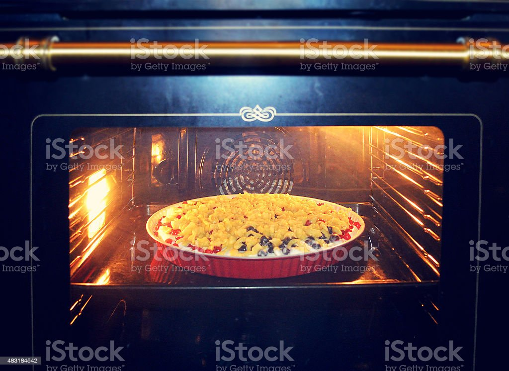 Currant cake in the oven stock photo