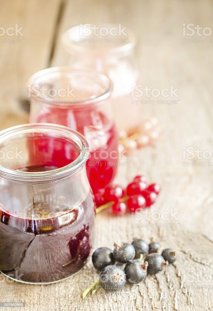 Currant jam with fresh berries stock photo