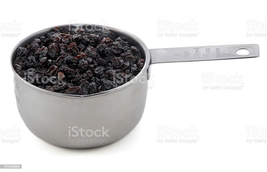 Currants presented in an American metal cup measure royalty-free stock photo