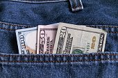 Currency bills in jeans hip pocket