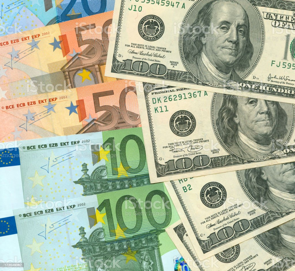 Currency exchange concept showing bills from both countries stock photo