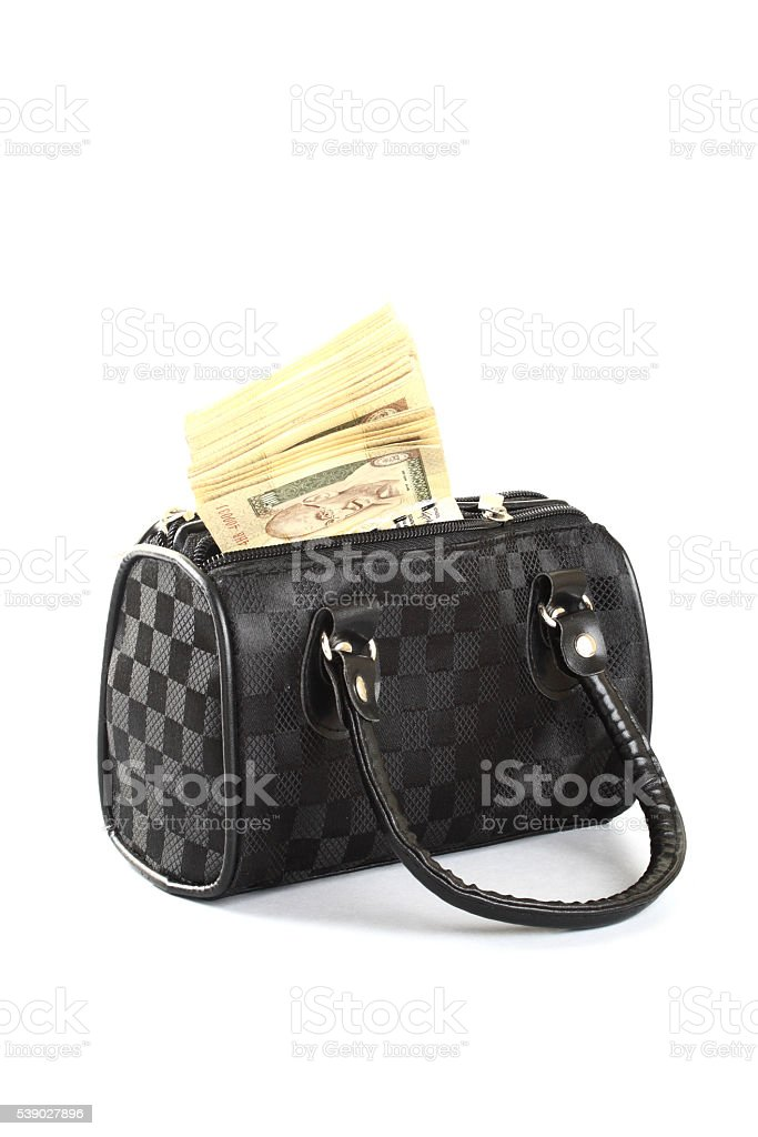 Currency in a ladies bag stock photo