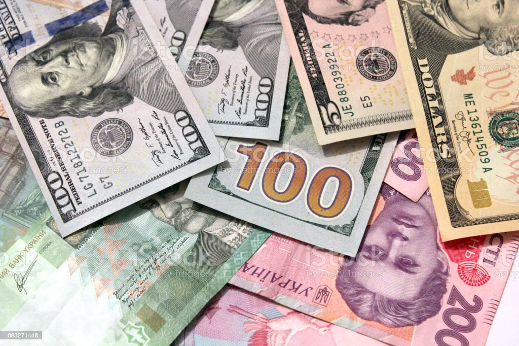 currency of American dollars on the grivnas bank notes stock photo