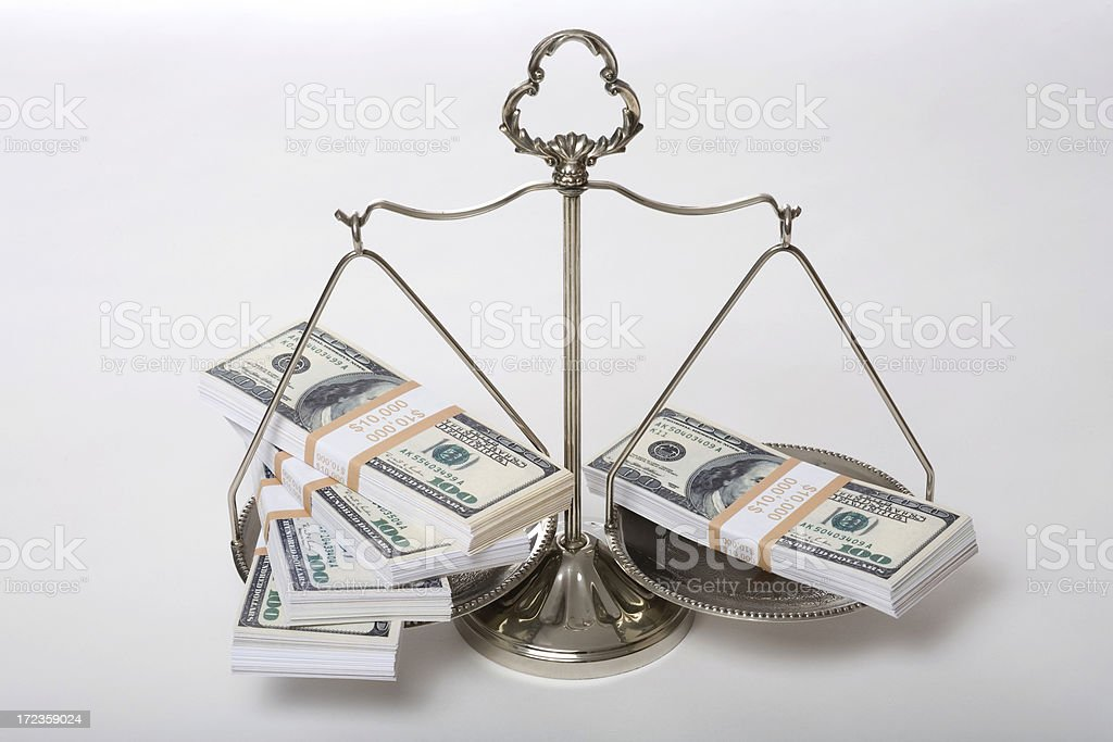 US currency on scale of justice royalty-free stock photo