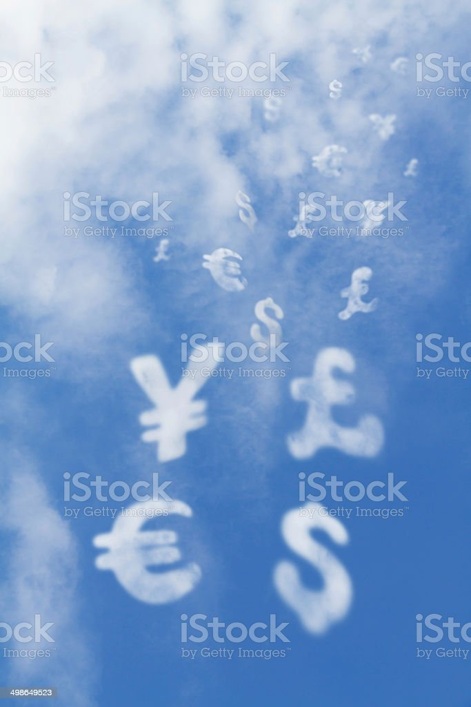 Currency shaped clouds falls from the sky stock photo