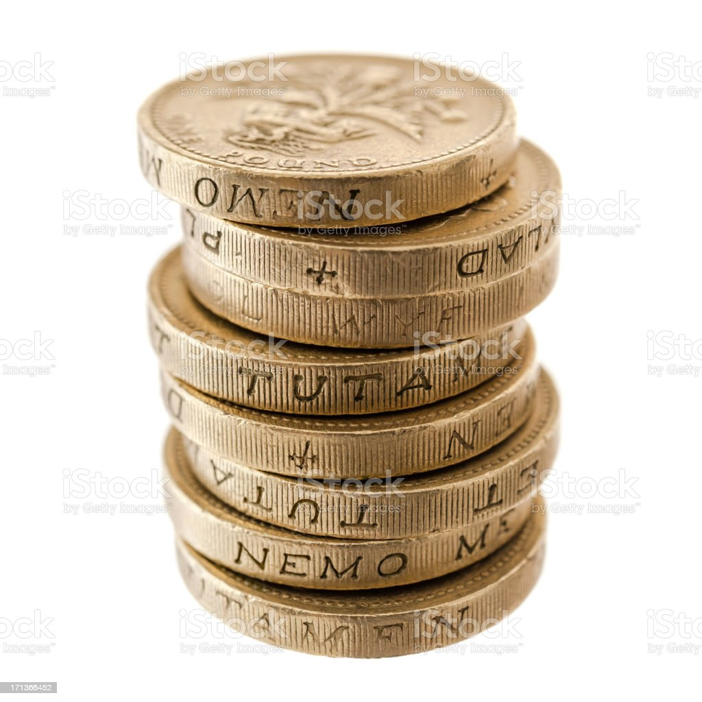 UK Currency: stack of one pound coins stock photo