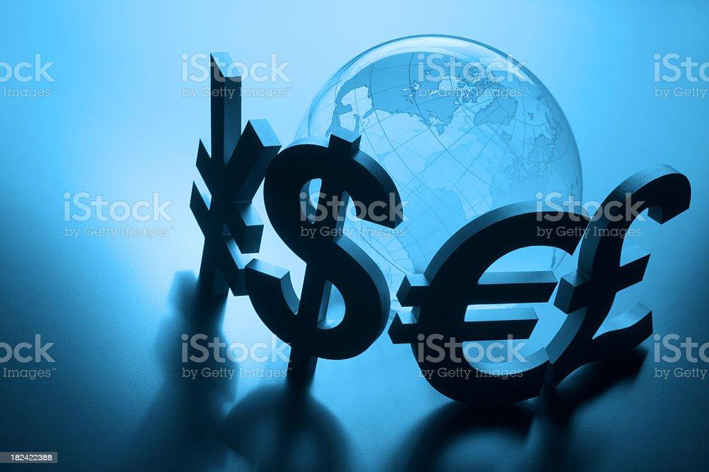 Currency symbols surround globe on blue background stock photo