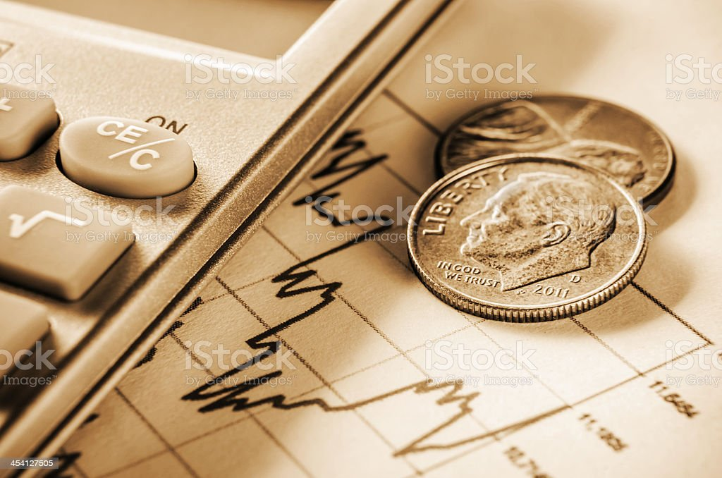 US currency with calculator on graph royalty-free stock photo