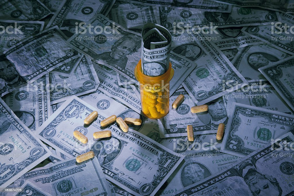 US Currency with pill bottle stock photo