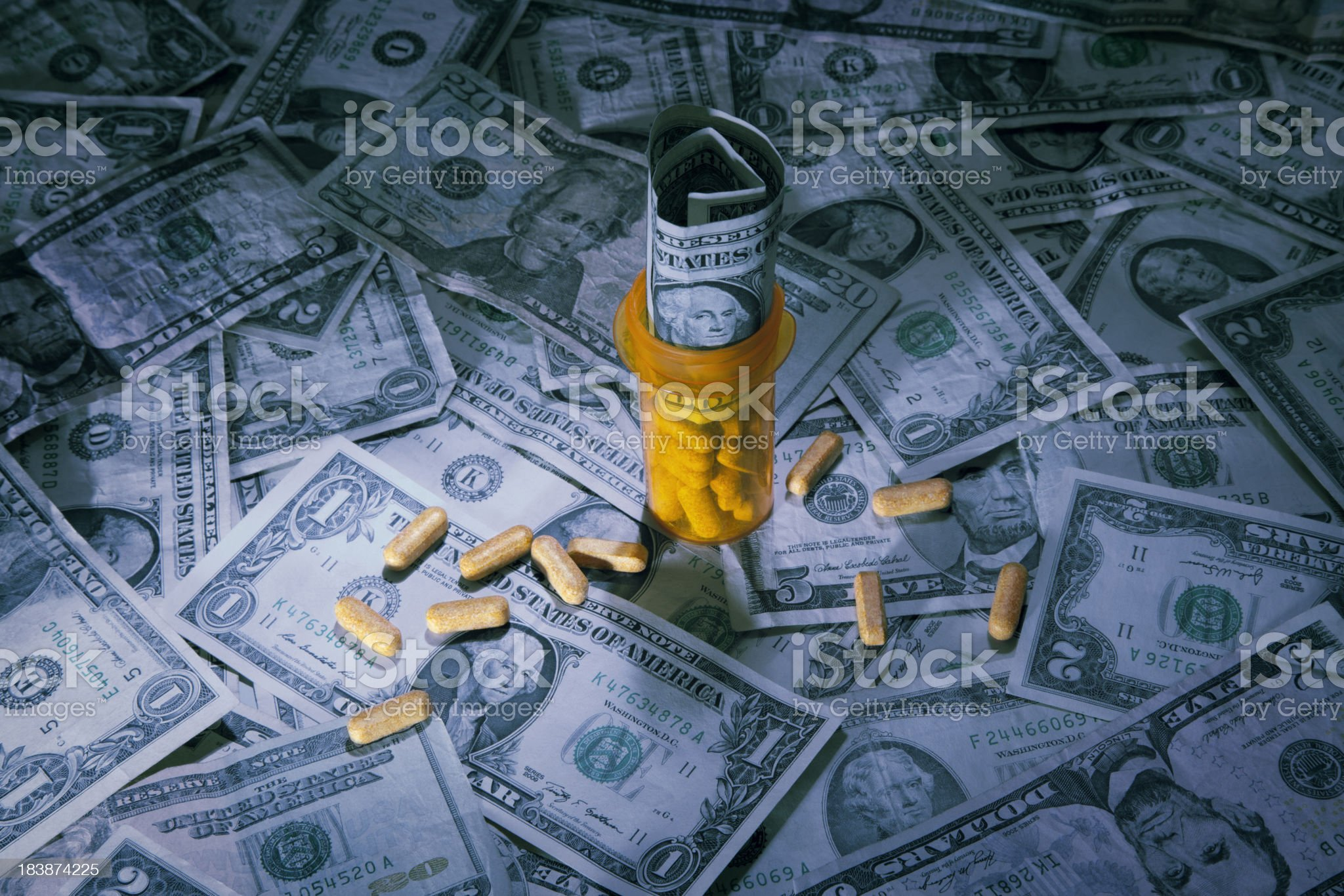 US Currency with pill bottle royalty-free stock photo