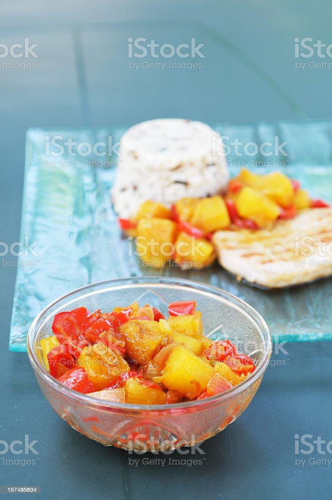 curried pineapple chutney and pork dish stock photo