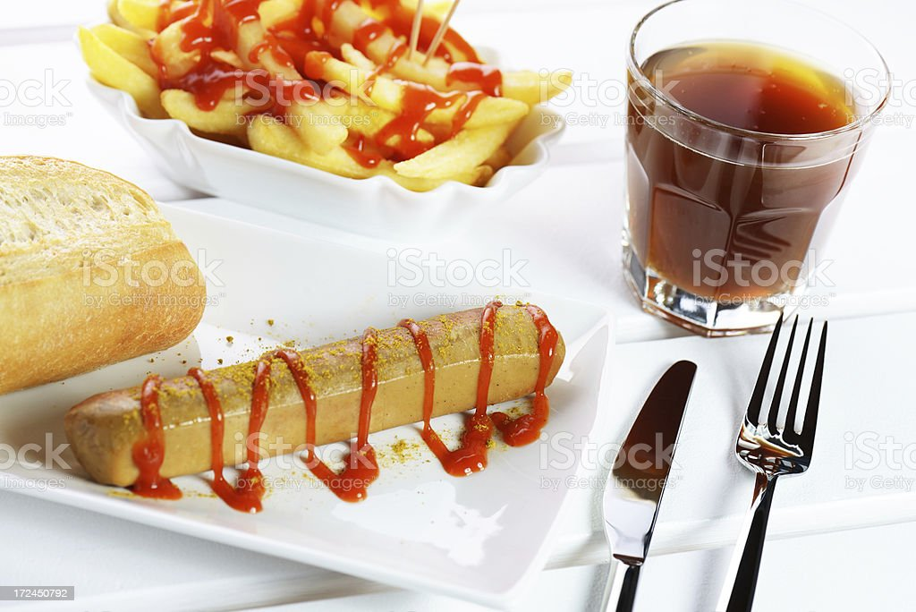 Curried sausage (Currywurst) and french fries stock photo