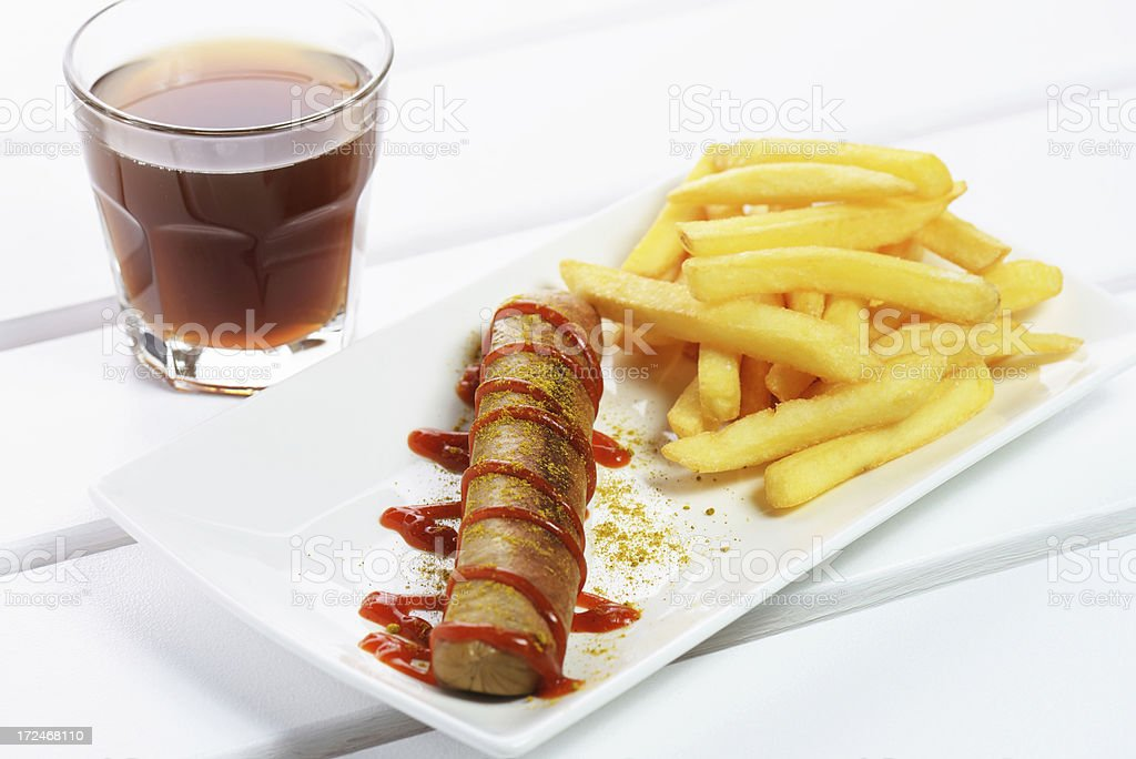 Curried sausage and french fries royalty-free stock photo