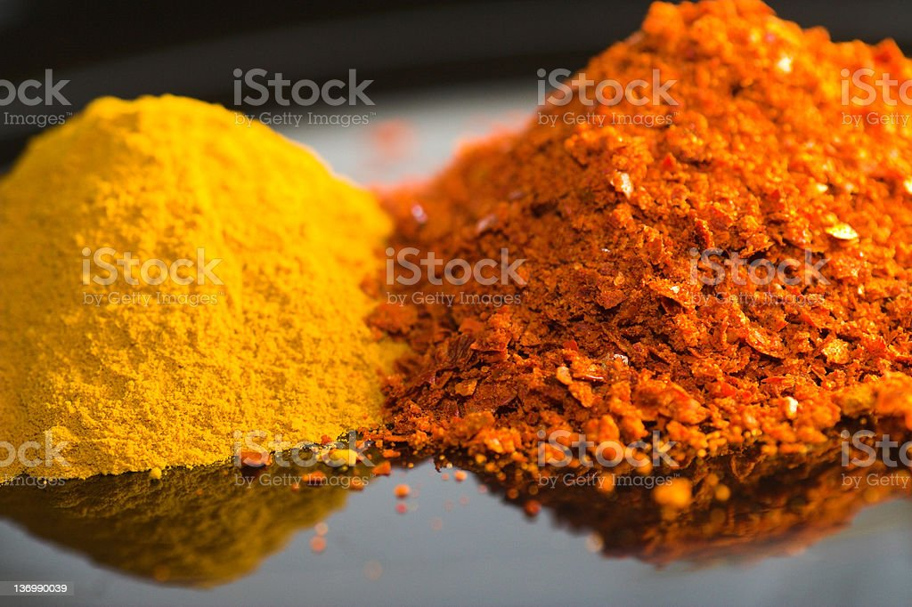 curry and chili powder on reflecting surface royalty-free stock photo
