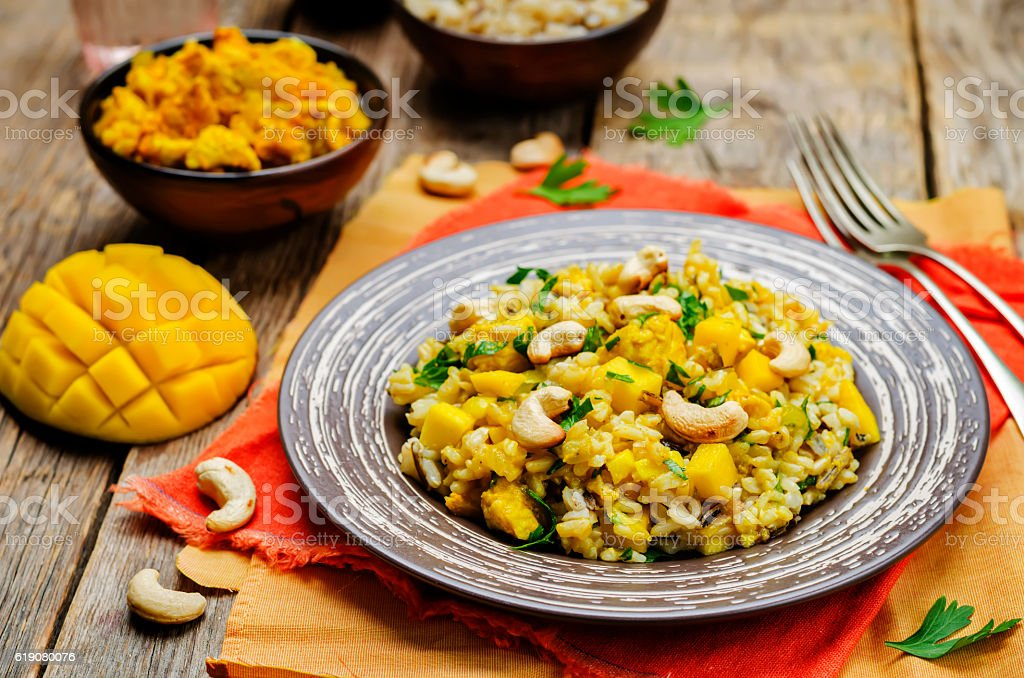 Curry chicken rice with mango stock photo