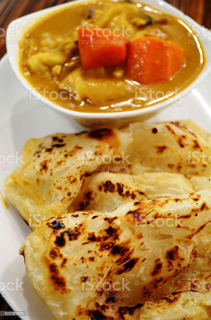 Curry dish with roti stock photo