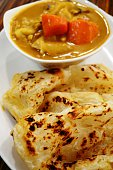 Curry dish with roti