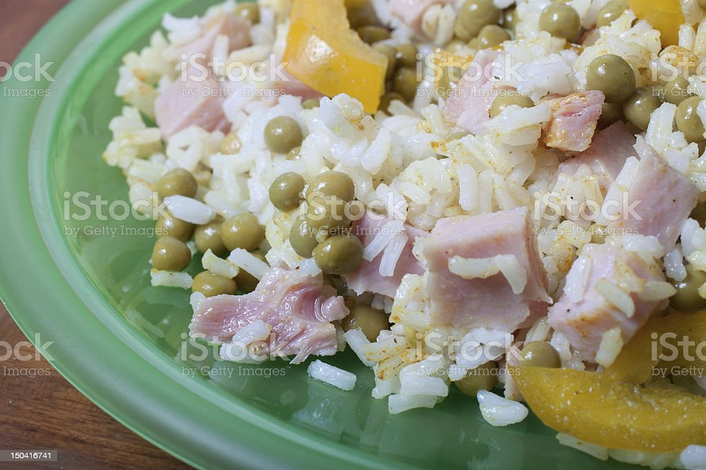 curry flavored rice with ham, peas and pepper royalty-free stock photo