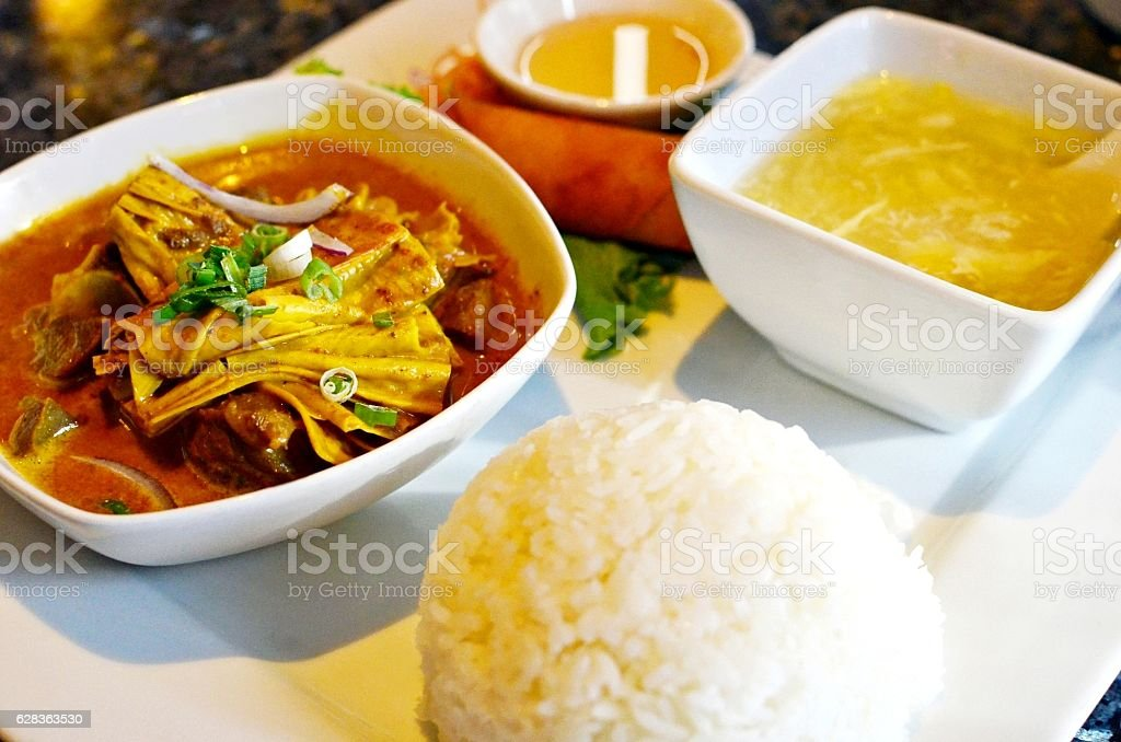 Curry lamb with steamed rice stock photo