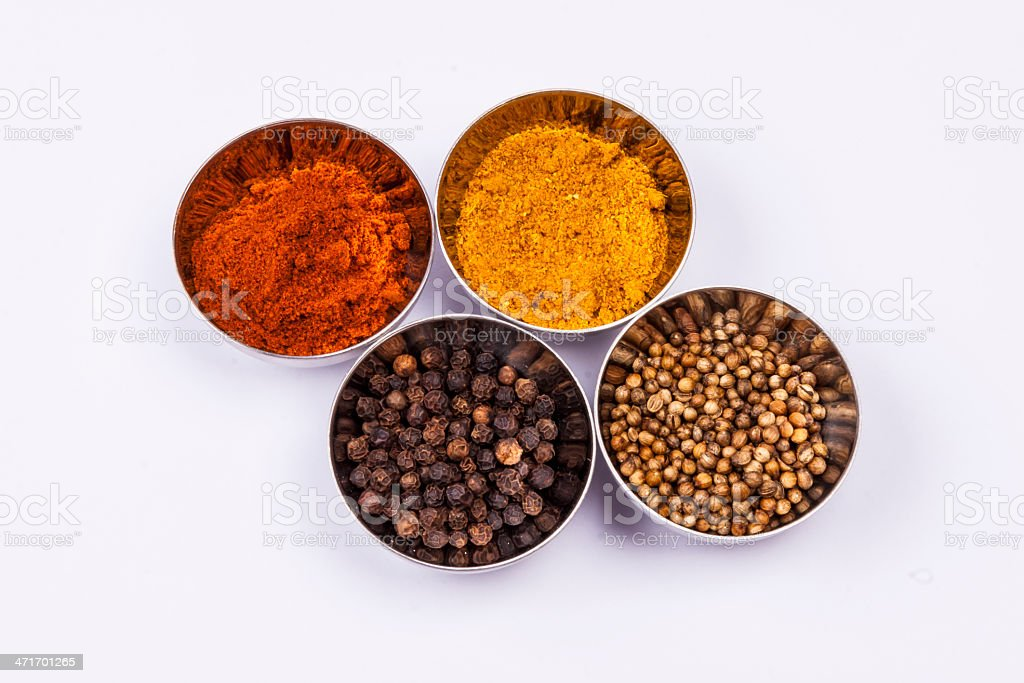 Curry, pepper,  paprika and coriander - white background. royalty-free stock photo